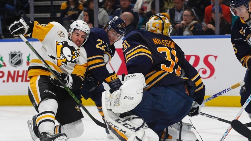Buffalo Sabres goalie Anders Nilsson (31) looks for the puck as Pittsburgh Penguins forward Sidney Crosby (87) is brought down during the second period of an NHL hockey game Saturday, Nov. 19, 2016, in Buffalo, N.Y. (AP Photo/Jeffrey T. Barnes)