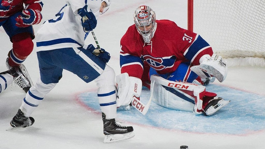 Montreal Canadiens goaltender Carey Price makes a save against Toronto Maple Leafs' James van Riemsdyk during the first period of an NHL hockey game in Montreal, Saturday, Nov. 19, 2016. (Graham Hughes/The Canadian Press via AP)