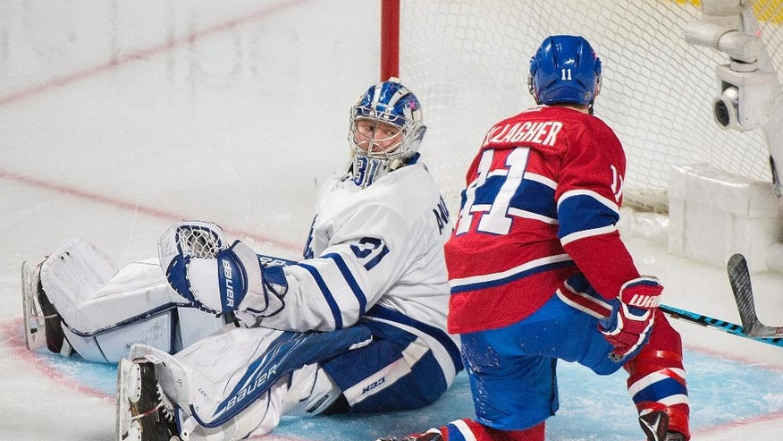 Toronto Maple Leafs goaltender Frederik Andersen looks back after being scored on by Montreal Canadiens' Alex Galchenyuk, not shown, as Canadiens' Brendan Gallagher looks for the rebound during the second period of an NHL hockey game in Montreal, Saturday, Nov. 19, 2016. (Graham Hughes/The Canadian Press via AP)
