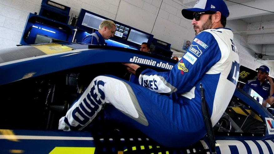 HOMESTEAD, FL - NOVEMBER 19: Jimmie Johnson, driver of the #48 Lowe's Chevrolet, climbs into his car during practice for the NASCAR Sprint Cup Series Ford EcoBoost 400 at Homestead-Miami Speedway on November 19, 2016 in Homestead, Florida. (Photo by Sean Gardner/NASCAR via Getty Images)