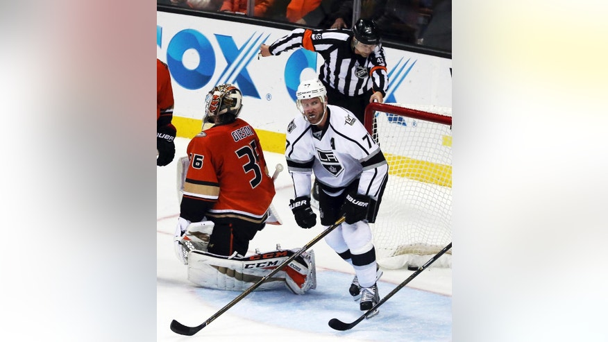 Referee Jake Brenk makes the call as Los Angeles Kings center Jeff Carter (77) scores a goal on Anaheim Ducks goalie John Gibson (36) in the second period of an NHL hockey game in Anaheim, Calif., Sunday, Nov. 20, 2016. (AP Photo/Reed Saxon)