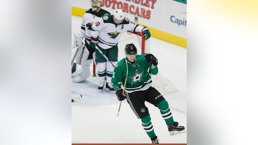 Dallas Stars defenseman Jamie Oleksiak (5) celebrates after scoring a goal against the Minnesota Wild during the second period of an NHL hockey game Monday, Nov 21, 2016, in Dallas. (AP Photo/Brandon Wade)