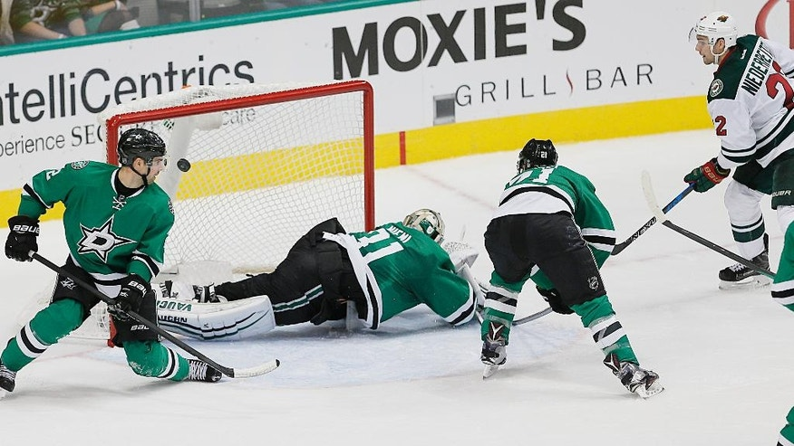 Minnesota Wild forward Nino Niederreiter, far right, scores a power play goal as Dallas Stars defenseman Dan Hamhuis, far left, goalie Antti Niemi (31) and forward Antoine Roussel (21) defend during the second period of an NHL hockey game Monday, Nov 21, 2016, in Dallas. (AP Photo/Brandon Wade)