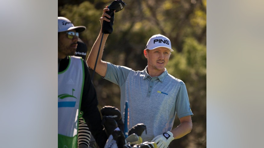 Mackenzie Hughes, of Canada, pulls a club out of his bag before his tee shot on the second fairway during the final round at the RSM Classic golf tournament, Sunday, Nov. 20, 2016, in St. Simons Island, Ga. (AP Photo/Stephen B. Morton)