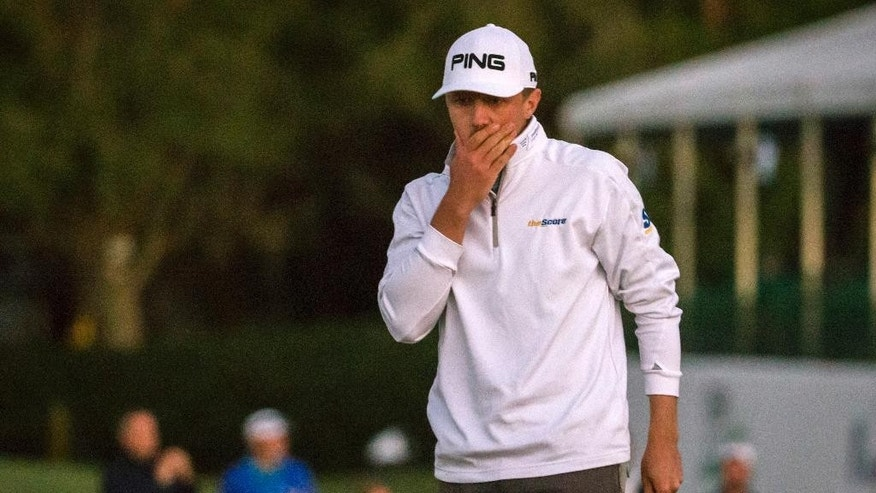 Mackenzie Hughes, of Canada, reacts to a missed birdie putt on the 18th green during second playoff of the final round at the RSM Classic golf tournament, Sunday, Nov. 20, 2016, in St. Simons Island, Ga. The day ended when play was suspended due to darkness. (AP Photo/Stephen B. Morton)