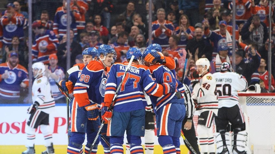 Edmonton Oilers celebrate a goal against the Chicago Blackhawks during first period NHL hockey action in Edmonton, Alberta, Monday, Nov. 21, 2016. (Jason Franson/The Canadian Press via AP)