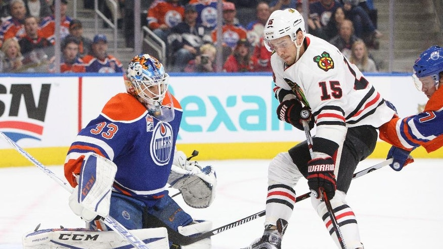 Chicago Blackhawks' Artem Anisimov (15) is stopped by Edmonton Oilers' goalie Cam Talbot (33) during first period NHL hockey action in Edmonton, Alberta, Monday Nov. 21, 2016. (Jason Franson/The Canadian Press via AP)