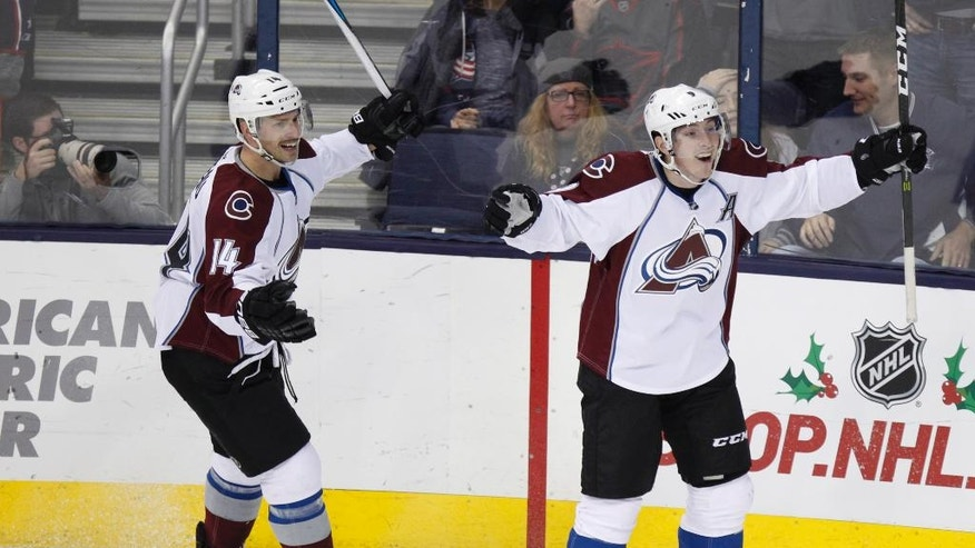 Colorado Avalanche forward Matt Duchene, right, celebrates his winning overtime goal against the Columbus Blue Jackets with teammate forward Blake Comeau during an NHL hockey game in Columbus, Ohio, Monday, Nov. 21, 2016. Colorado won 3-2. (AP Photo/Paul Vernon)