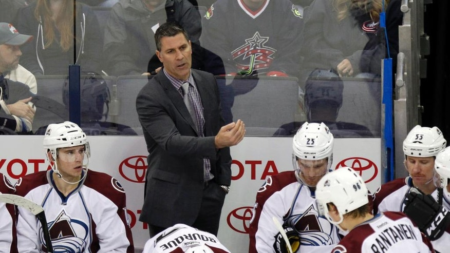 Colorado Avalanche coach Jared Bednar, center, talks to members of his team during the third period of an NHL hockey game against the Columbus Blue Jackets in Columbus, Ohio, Monday, Nov. 21, 2016. (AP Photo/Paul Vernon)