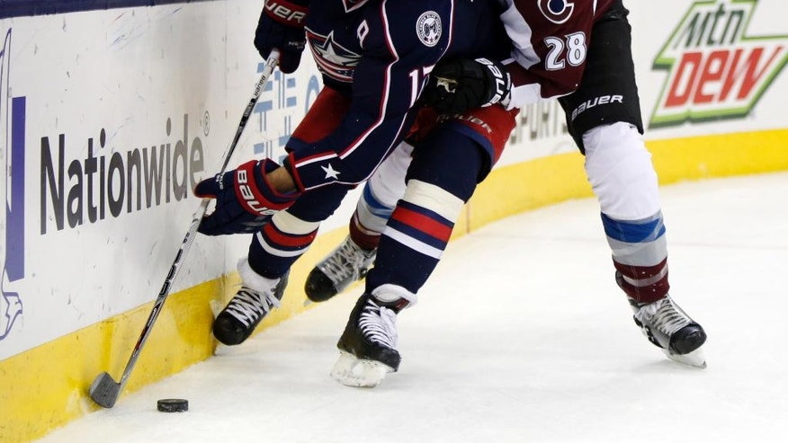 Columbus Blue Jackets forward Brandon Dubinsky, left, works for the puck against Colorado Avalanche defenseman Patrick Wiercioch during the second period of an NHL hockey game in Columbus, Ohio, Monday, Nov. 21, 2016. (AP Photo/Paul Vernon)