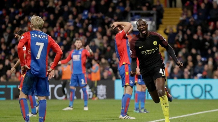 Manchester City's Yaya Toure, right, celebrates scoring his side's second goal during the English Premier League soccer match between Crystal Palace and Manchester City at Selhurst Park stadium in London, Saturday, Nov. 19, 2016. (AP Photo/Matt Dunham)