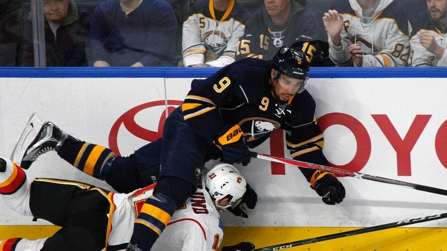 Buffalo Sabres forward Evander Kane (9) collides with Calgary Flames forward Mikael Backlund (11) during the second period of an NHL hockey game, Monday, Nov. 21, 2016, in Buffalo, N.Y. (AP Photo/Jeffrey T. Barnes)