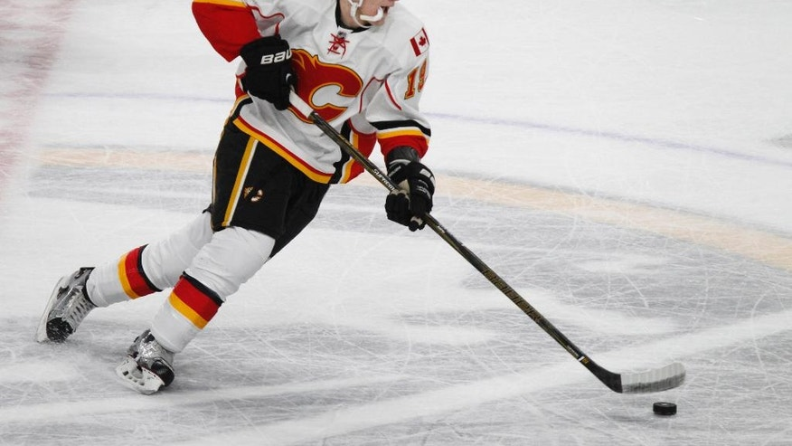 Calgary Flames rookie left wing Matthew Tkachuk (19) skates with the puck during the second period of an NHL hockey game against the Buffalo Sabres, Monday, Nov. 21, 2016, in Buffalo, N.Y. (AP Photo/Jeffrey T. Barnes)