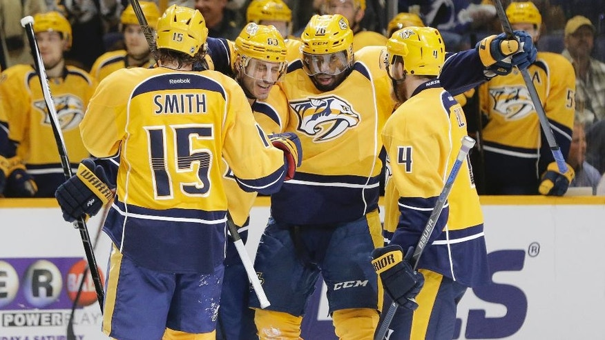 Nashville Predators defenseman P.K. Subban (76) celebrates with Craig Smith (15), Mike Ribeiro (63) and Ryan Ellis (4) after scoring his second goal of an NHL hockey game against the Tampa Bay Lightning during the second period Monday, Nov. 21, 2016, in Nashville, Tenn. (AP Photo/Mark Humphrey)