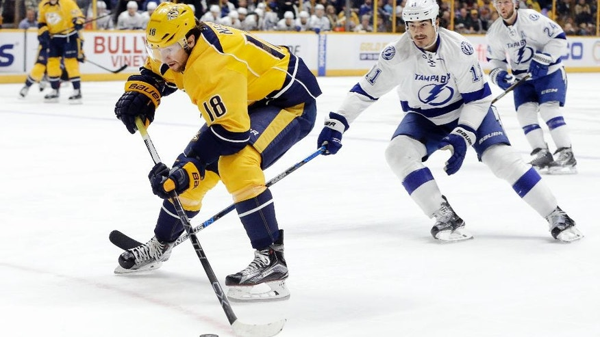 Tampa Bay Lightning center Brian Boyle (11) tries to slow down Nashville Predators right wing James Neal (18) during the second period of an NHL hockey game Monday, Nov. 21, 2016, in Nashville, Tenn. (AP Photo/Mark Humphrey)