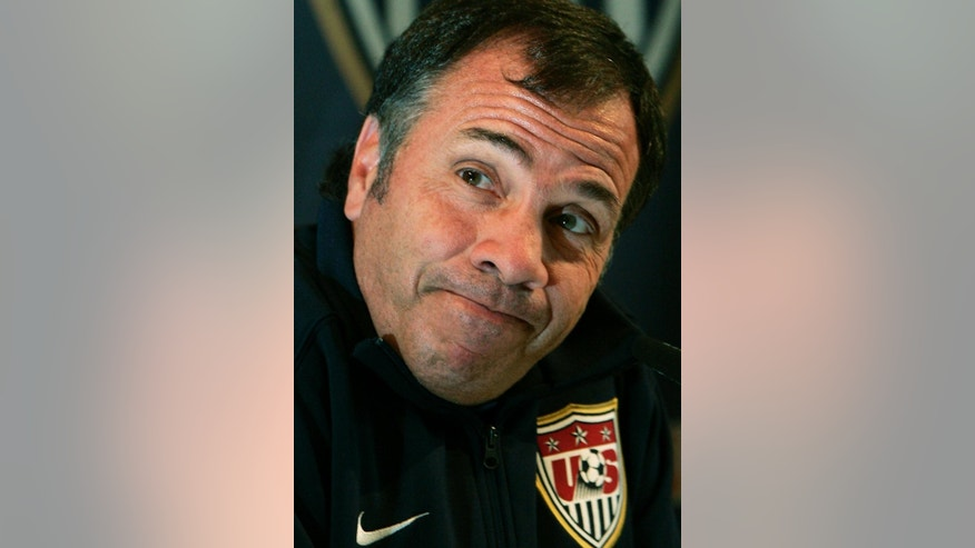 FILE - In this June 13, 2006, file photo, United States national soccer team manager Bruce Arena reacts as he speaks during a news conference in Hamburg, Germany, the day after they lost, 3-0, to the Czech Republic in a Group E, World Cup soccer match. Arena is returning to coach the U.S. national team, a decade after he was fired.  The winningest coach in American national team history, Arena took over Tuesday, Nov. 22, 2016, one day after Jurgen Klinsmann was fired.  (AP Photo/Elise Amendola, File)