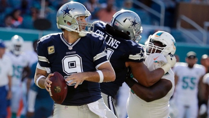 Dallas Cowboys quarterback Tony Romo (9) looks to pass during the second half of an NFL football game against the Miami Dolphins, Sunday, Nov. 22, 2015, in Miami Gardens, Fla.  (AP Photo/Lynne Sladky)