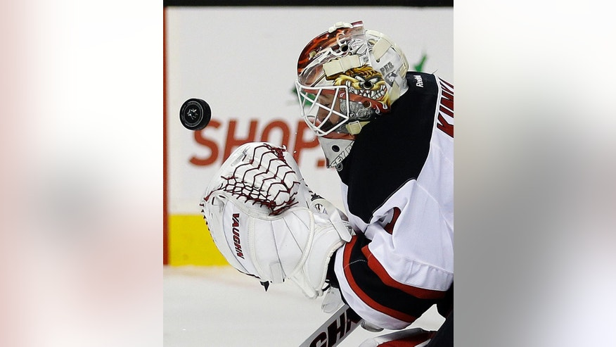 New Jersey Devils goalie Keith Kinkaid makes the save on a shot from the San Jose Sharks during the first period of an NHL hockey game Monday, Nov. 21, 2016, in San Jose, Calif. (AP Photo/Ben Margot)