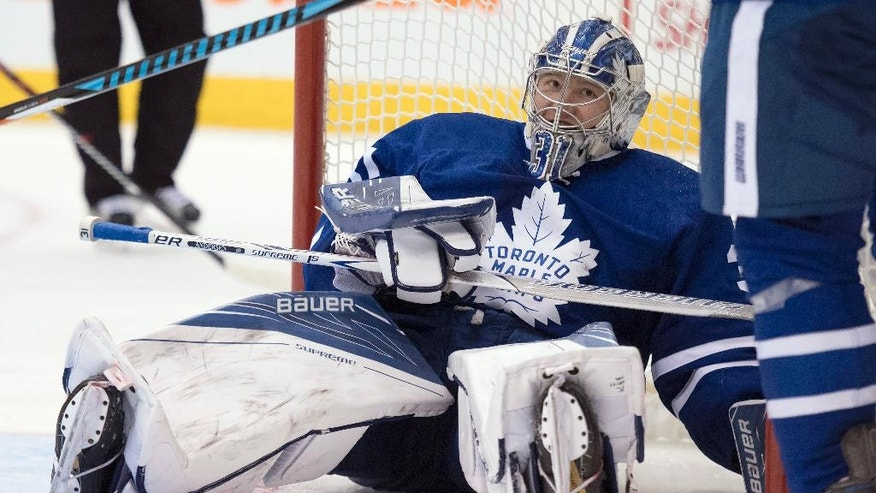 Toronto Maple Leafs goalie Frederik Andersen looks up after getting driven into the goal during the third period of the team's NHL hockey game against the Carolina Hurricanes in Toronto on Tuesday, Nov. 22, 2016. (Frank Gunn/The Canadian Press via AP)