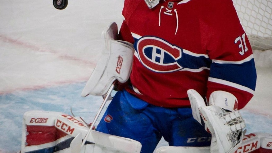 Montreal Canadiens goalie Carey Price watches the puck sail wide of the net during the first period of an NHL hockey game against the Ottawa Senators, Tuesday, Nov. 22, 2016 in Montreal. (Peter McCabe/The Canadian Press via AP)