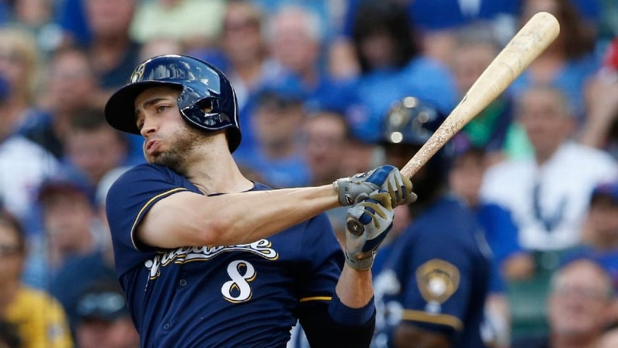 The Milwaukee Brewers' Ryan Braun hits a one-run single against the Chicago Cubs during the fourth inning.