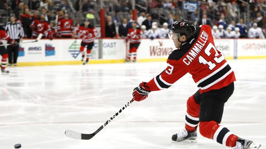 New Jersey Devils left wing Michael Cammalleri assists on a goal by center Travis Zajac, not pictured, during the second period of an NHL hockey game against the Toronto Maple Leafs, Wednesday, Nov. 23, 2016, in Newark, N.J. (AP Photo/Julio Cortez)