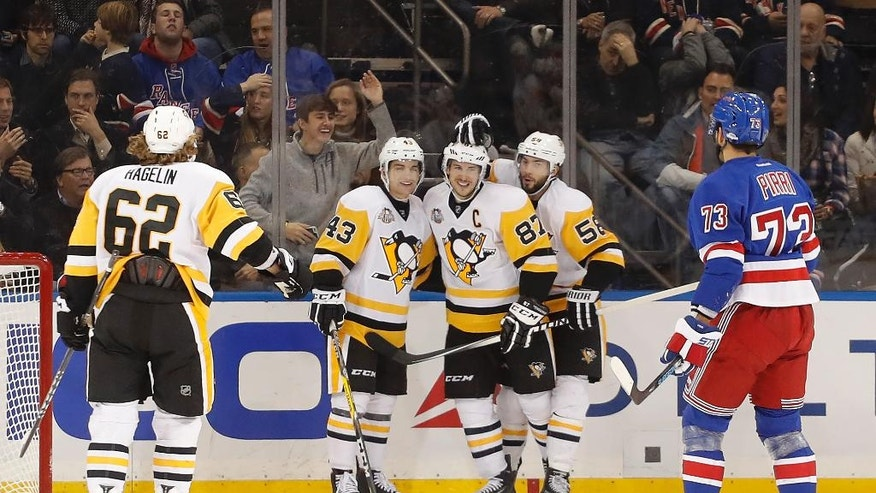 Pittsburgh Penguins center Sidney Crosby (87) is congratulated by teammates after scoring a goal against the New York Rangers during the second period of an NHL hockey game, Wednesday, Nov. 23, 2016, in New York. (AP Photo/Julie Jacobson)