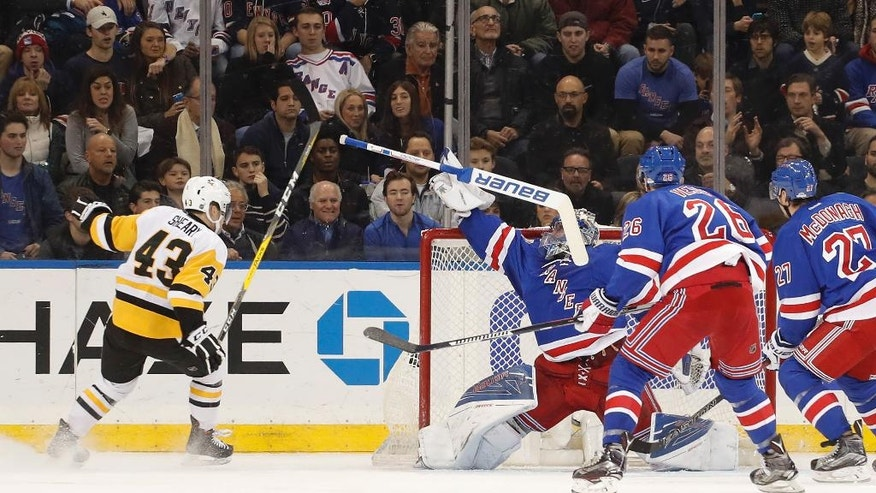 New York Rangers goalie Henrik Lundqvist (30) loses his stick as the puck drops into the net for a goal by the Pittsburgh Penguins during the second period of an NHL hockey game, Wednesday, Nov. 23, 2016, in New York. Pittsburgh Penguins center Sidney Crosby (87) was credited with the goal on the play. (AP Photo/Julie Jacobson)