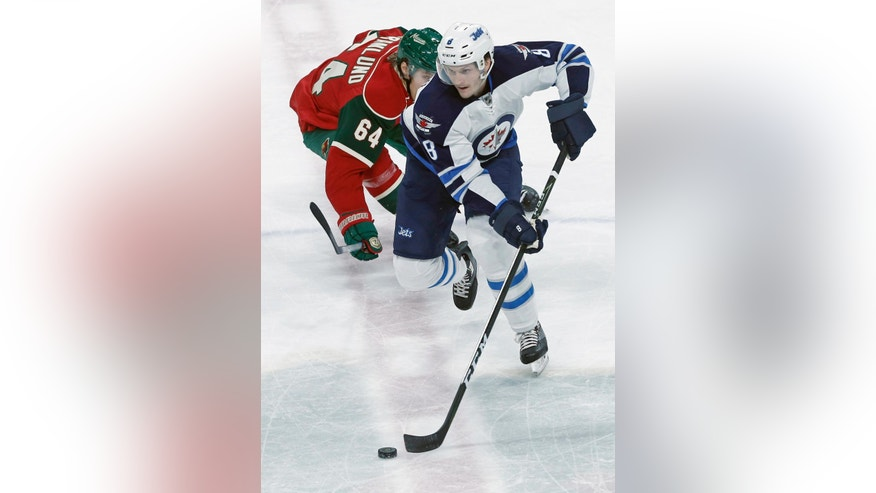 Minnesota Wild's Mikael Granlund, left, pursues Winnipeg Jets' Jacob Trouba during the first period of an NHL hockey game Wednesday, Nov. 23, 2016, in St. Paul, Minn. (AP Photo/Jim Mone)
