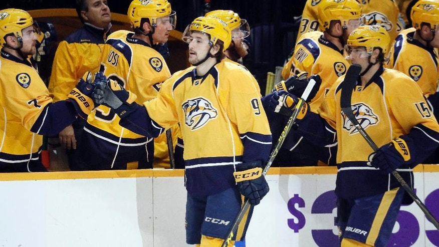 Nashville Predators left wing Filip Forsberg (9), of Sweden, is congratulated after scoring a goal against the Dallas Stars during the first period of an NHL hockey game Wednesday, Nov. 23, 2016, in Nashville, Tenn. (AP Photo/Mark Humphrey)