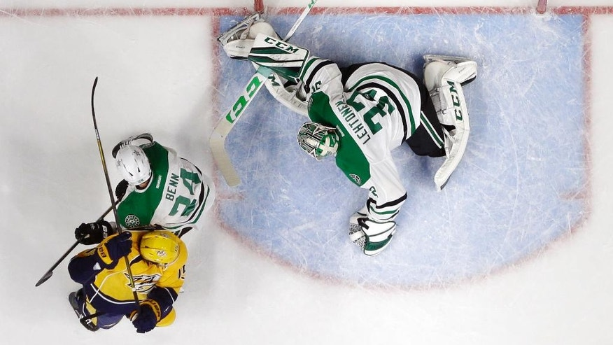 Dallas Stars goalie Kari Lehtonen (32), of Finland, tries to block a shot by Nashville Predators left wing Filip Forsberg, not shown, as it gets past for a goal during the first period of an NHL hockey game Wednesday, Nov. 23, 2016, in Nashville, Tenn. At left are Predators right wing Craig Smith (15) and Stars defenseman Jordie Benn (24). (AP Photo/Mark Humphrey)