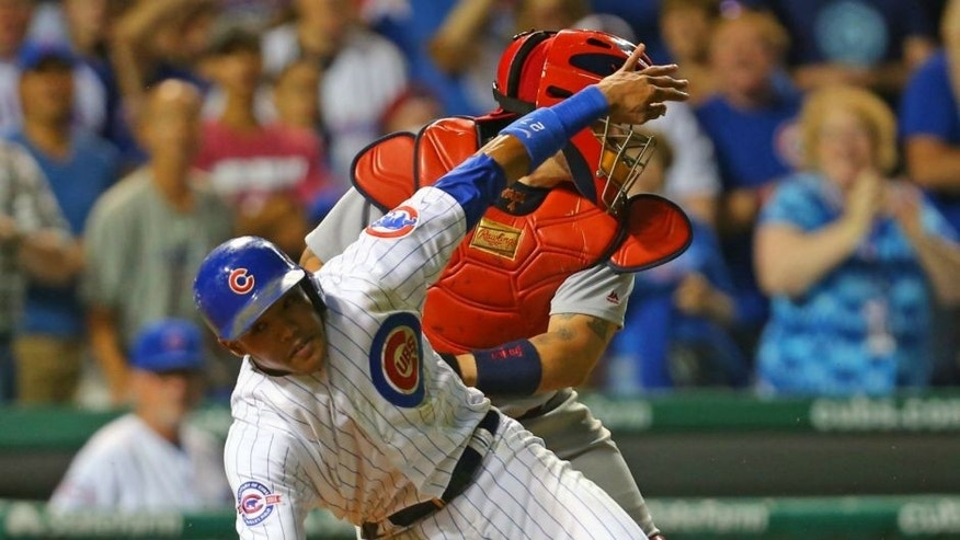 Sep 25, 2016; Chicago, IL, USA; Chicago Cubs shortstop Addison Russell (27) is tagged out at home by St. Louis Cardinals catcher Yadier Molina (4) during the eighth inning at Wrigley Field. Mandatory Credit: Dennis Wierzbicki-USA TODAY Sports