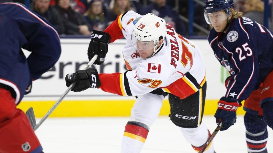 Calgary Flames' Micheal Ferland shoots and scores against the Columbus Blue Jackets' during the third period of an NHL hockey game Wednesday, Nov. 23, 2016, in Columbus, Ohio. The Flames beat the Blue Jackets 2-0. (AP Photo/Jay LaPrete)