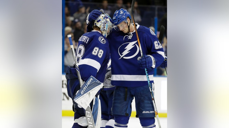 Tampa Bay Lightning defenseman Andrej Sustr (62), of the Czech Republic, celebrates with goalie Andrei Vasilevskiy (88), of Russia, after the Lightning defeated the Philadelphia Flyers 4-2 during an NHL hockey game Wednesday, Nov. 23, 2016, in Tampa, Fla. (AP Photo/Chris O'Meara)