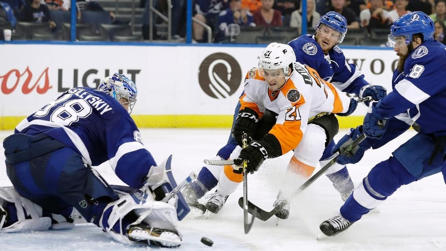 Tampa Bay Lightning goalie Andrei Vasilevskiy (88), of Russia, makes the save on a shot by Philadelphia Flyers center Scott Laughton (21) during the third period of an NHL hockey game Wednesday, Nov. 23, 2016, in Tampa, Fla. The Lightning won the game 4-2. Defending is defenseman Luke Witkowski (28) and right wing Erik Condra (22). (AP Photo/Chris O'Meara)