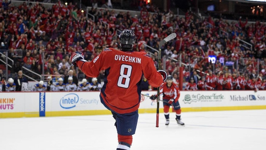 Washington Capitals left wing Alex Ovechkin (8), of Russia, celebrates his goal during the first period of the team's NHL hockey game against the St. Louis Blues, Wednesday, Nov. 23, 2016, in Washington. (AP Photo/Nick Wass)
