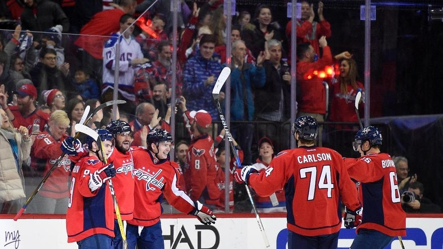 Washington Capitals left wing Alex Ovechkin, second from left, celebrates his goal with Dmitry Orlov (9), Evgeny Kuznetsov, third from left, John Carlson (74) and Andre Burakovsky (65) during the second period of an NHL hockey game against the St. Louis Blues, Wednesday, Nov. 23, 2016, in Washington. (AP Photo/Nick Wass)