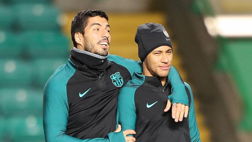 Barcelona's Neymar, right, and Luis Suarez attend a training session ahead at Celtic Park, Glasgow, Scotland, Tuesday, Nov. 22, 2016. Barcelona will play Celtic in a Champions League Group C soccer match on Wednesday. (Andrew Milligan/PA via AP)
