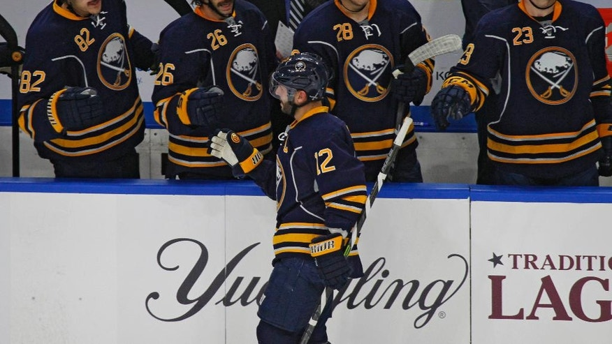 Buffalo Sabres forward Brian Gionta (12) celebrates his goal against the Detroit Red Wings during the third period of an NHL hockey game, Wednesday, Nov. 23, 2016, in Buffalo, N.Y. (AP Photo/Jeffrey T. Barnes)