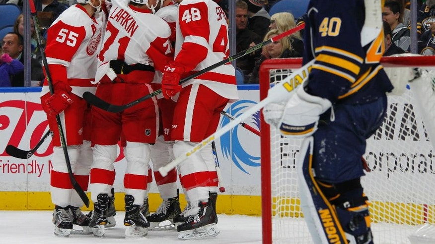 Detroit Red Wings celebrate a goal during the second period of an NHL hockey game against the Buffalo Sabres, Wednesday, Nov. 23, 2016, in Buffalo, N.Y. (AP Photo/Jeffrey T. Barnes)
