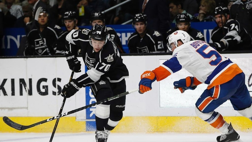 Los Angeles Kings left wing Tanner Pearson, left, controls the puck against New York Islanders defenseman Johnny Boychuk, right, during the second period of an NHL hockey game in Los Angeles, Wednesday, Nov. 23, 2016. (AP Photo/Alex Gallardo)