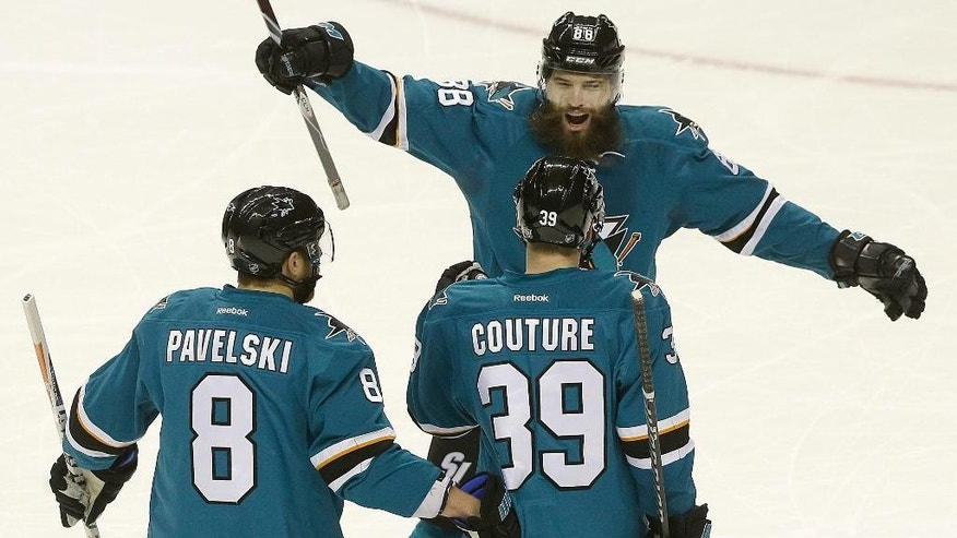 San Jose Sharks center Logan Couture (39) celebrates after scoring a goal with center Joe Pavelski (8) and defenseman Brent Burns (88) during the first period of an NHL hockey game against the Chicago Blackhawks in San Jose, Calif., Wednesday, Nov. 23, 2016. (AP Photo/Jeff Chiu)