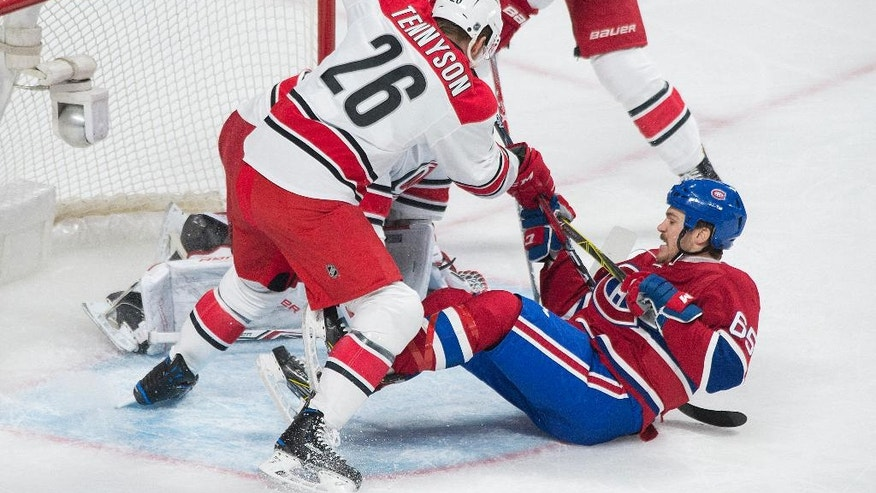Montreal Canadiens' Andrew Shaw (65) scores against the Carolina Hurricanes as Hurricanes' Matt Tennyson defends during the first period of ab NHL hockey game in Montreal, Thursday, Nov. 24, 2016. (Graham Hughes/The Canadian Press via AP)