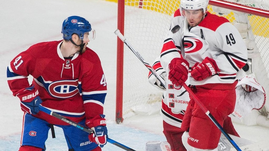 Montreal Canadiens' Paul Byron (41) moves in on Carolina Hurricanes' Victor Rask during the second period of an NHL hockey game in Montreal, Thursday, Nov. 24, 2016. (Graham Hughes/The Canadian Press via AP)