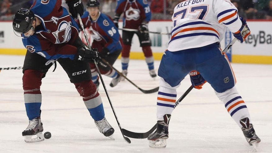 Colorado Avalanche center Nathan MacKinnon, left, loses control of the puck as Edmonton Oilers defenseman Oscar Klefbom, of Sweden, defends in the first period of an NHL hockey game late Wednesday, Nov. 23, 2016, in Denver. (AP Photo/David Zalubowski)