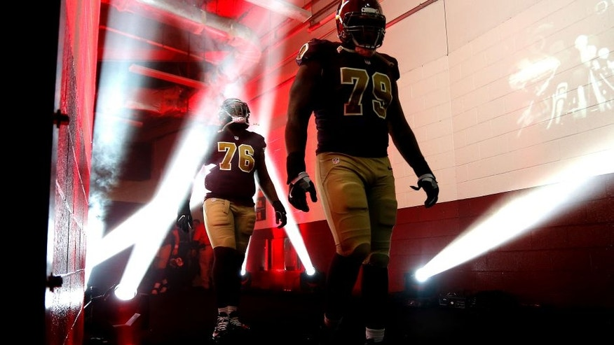 LANDOVER, MD - NOVEMBER 13: Tackle Ty Nsekhe #79 of the Washington Redskins and teammate tackle Morgan Moses #76 walk onto the field prior to a game against the Minnesota Vikings at FedExField on November 13, 2016 in Landover, Maryland. (Photo by Matt Hazlett/Getty Images)