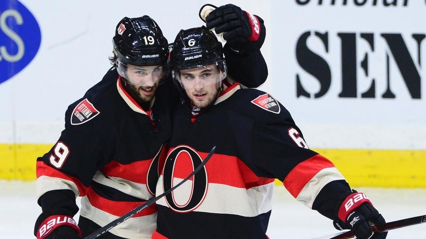 Ottawa Senators' Chris Wideman and Derick Brassard celebrate the winning goal against the Boston Bruins during third-period NHL hockey game action in Ottawa, Thursday, Nov. 24, 2016. (Sean Kilpatrick/The Canadian Press via AP)