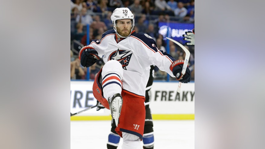 Columbus Blue Jackets left wing Brandon Saad (20) celebrates after scoring against the Tampa Bay Lightning during the third period of an NHL hockey game Friday, Nov. 25, 2016, in Tampa, Fla. The Blue Jackets won the game 5-3. (AP Photo/Chris O'Meara)