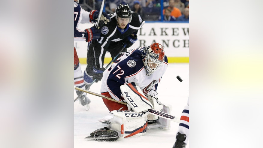 Columbus Blue Jackets goalie Sergei Bobrovsky (72), of Russia, makes a save on a shot by the Tampa Bay Lightning during the second period of an NHL hockey game Friday, Nov. 25, 2016, in Tampa, Fla. (AP Photo/Chris O'Meara)