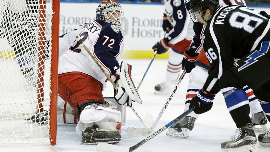 Tampa Bay Lightning right wing Nikita Kucherov (86), of Russia, scores past Columbus Blue Jackets goalie Sergei Bobrovsky (72), of Russia, during the second period of an NHL hockey game Friday, Nov. 25, 2016, in Tampa, Fla. (AP Photo/Chris O'Meara)